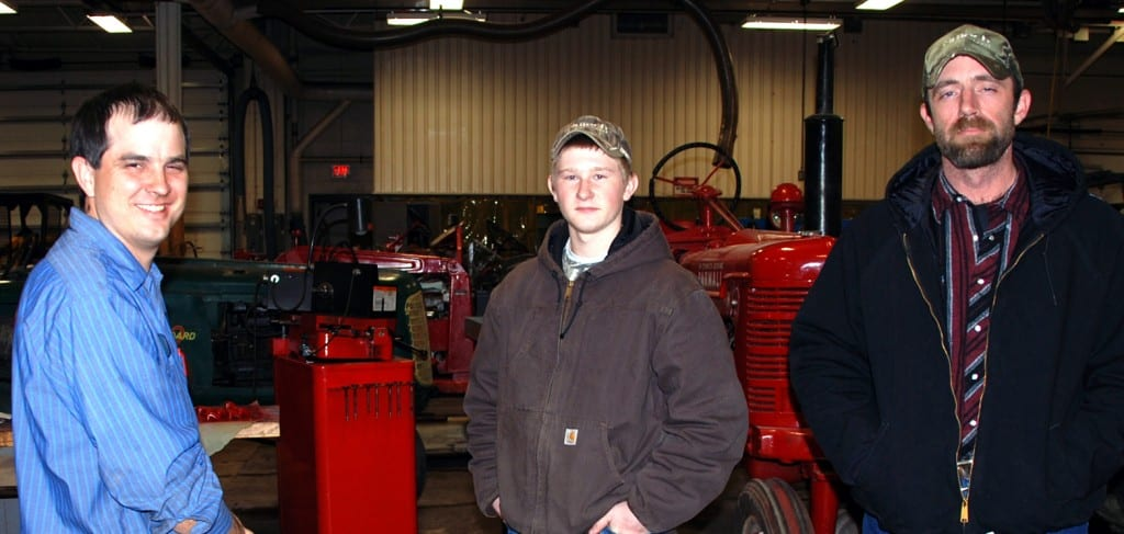 Four County Career Center hosted a Career Night Open House Monday evening with the Career Center's labs and classrooms open to the public. Instructors and counselors were available to answer questions and acquaint visitors with career and technical programs and college credit options. Shown talking about the Agriculture/Diesel Mechanics program at the Career Center are (LEFT TO RIGHT) Agriculture/Diesel Mechanics instructor Jason Elston; with Kenny Fish; and Matt Mulligan (both from Edon).