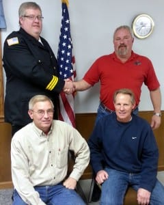 NEW APPOINTMENT ... Shown at a recent meeting congratulating Chief Shindledecker are (seated) Township Trustees Steve Planson and Ed Ruffer.  Standing:  Chief Tad Shindledecker and Township Trustee Rusty Goebel.