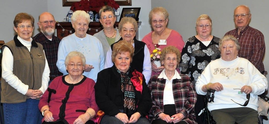 SPECIAL DAY … Celebrating January Birthdays at Montpelier Senior Center on Friday, January 11, 2013 were, seated from left, Margaret Gordon, Beverly Laughlin, Marge Michael, Mary Ellen Pressler and standing from left, Elnor Geren, Jim Martin, Vi Pressler, Sharon White, Beatrice Bechtol, Joanne Stemen, Donna Stahler and Richard Apt.  Assisting as servers for this month's Birthday celebration, hosted by Evergreen Manor Nursing Home, were T.R.U.S.T. students from Bryan High School.  Site Manager Jewel Head was also pleased to announce Joanne Stemen (floral arrangement from Huntington Bank tellers) and Margaret Gordon (two free Senior Center Lunches) as January's Monthly Door Prize winners.