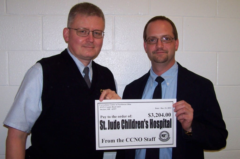 DONATION ... CCNO Corrections Supervisor Pat Miller and Corrections Officer John Zimman holding a check to be presented to St. Jude Children's Research Hospital.  Supervisor Miller donated numerous handmade items for the raffle while Officer Zimman was the lucky recipient of several donated items.