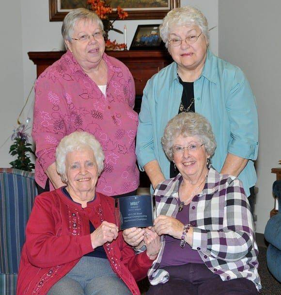 PHYSCO LADIES … Members of the 2013 Conference-winning team are from left, seated, Carol Brumbaugh, Marsha Snyder and standing, Anita Taylor, Judy White.
