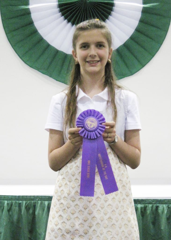 4-H Outstanding of the Day award ... On Thursday, July 25, 2013, eleven year old Jaelina Mitchell, member of the Stryker Livestock 4-H Club, entered her 4-H project, Scrapbooking-Jr, in the Ohio State Fair,  4-H competition. This was Jaelina's first trip to State Competition. She placed as a Finalist and was awarded an Outstanding of the Day ribbon. Jaelina is the daughter of Gayland and Toni Mitchell.